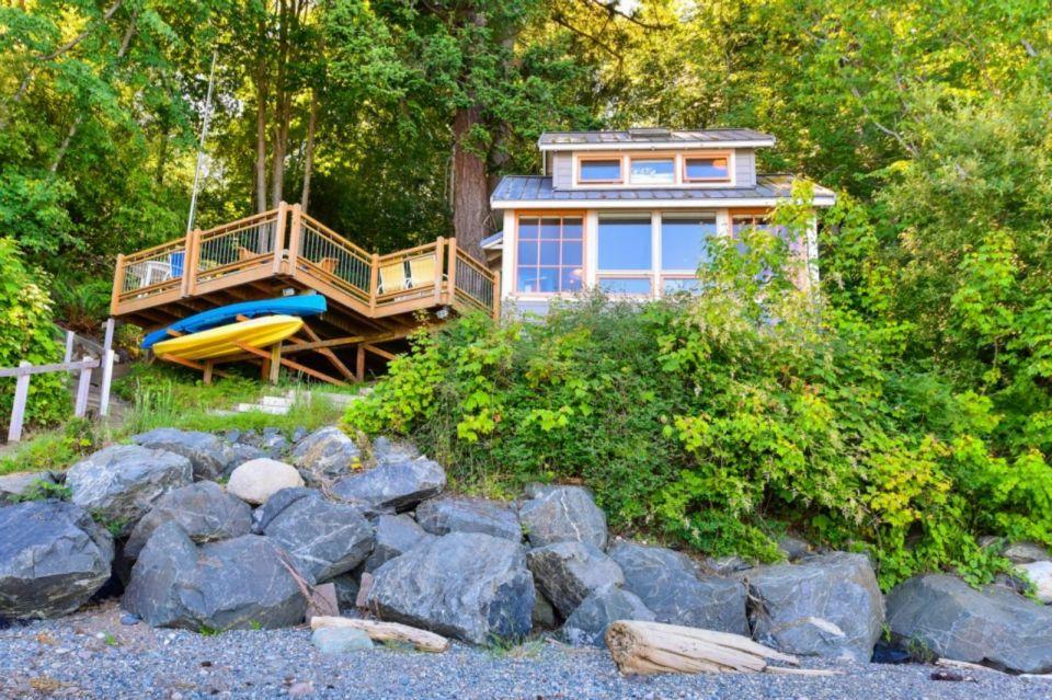 A tiny cottage on Washington's Lummi Island. The 458 sq ft cottage has a distinctive roof lantern to accommodate a loft bedroom.   www.facebook.com/SmallHouseBliss