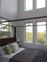 This small beach house, elevated for protection from storm surges, has one bedroom and a loft in a 24' square footprint. | www.facebook.com/SmallHouseBliss