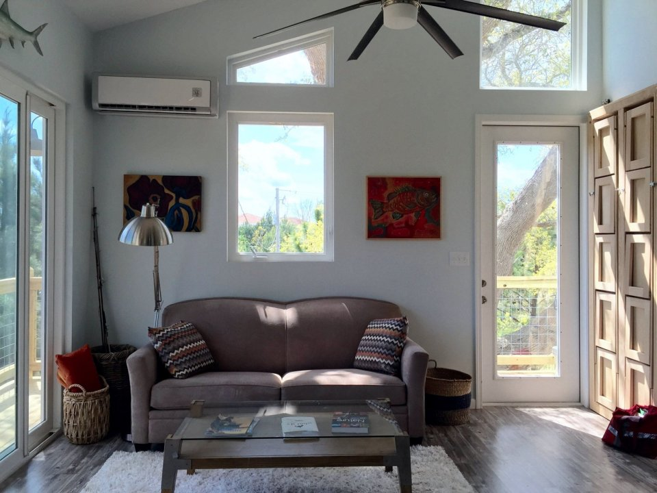 This small beach house, elevated for protection from storm surges, has one bedroom and a loft in a 24' square footprint.   www.facebook.com/SmallHouseBliss