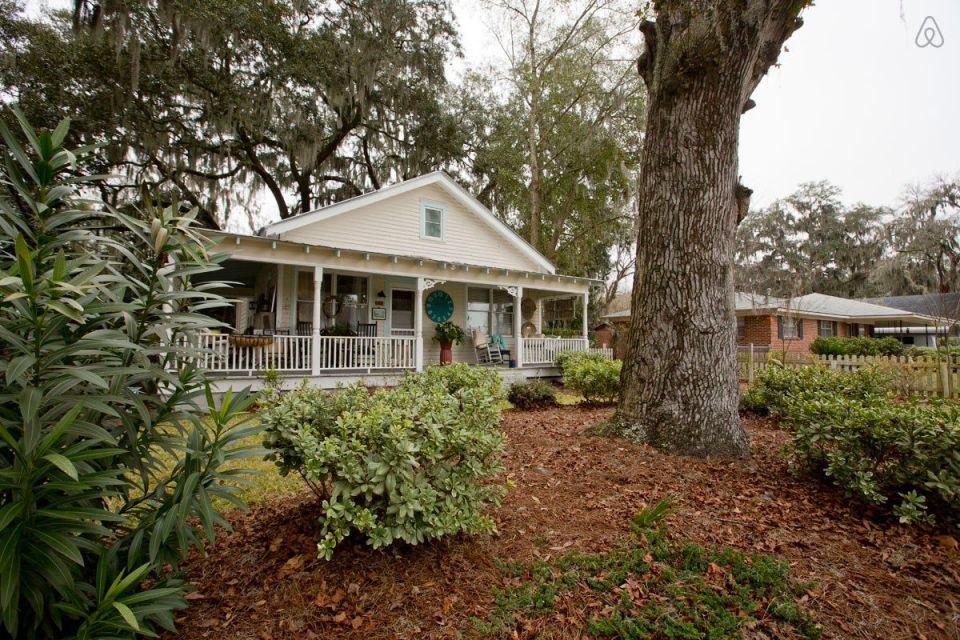 This modest two-bedroom bungalow outside Savannah, Georgia features a spacious wraparound porch. | www.facebook.com/SmallHouseBliss