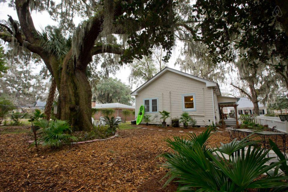 This modest two-bedroom bungalow outside Savannah, Georgia features a spacious wraparound porch.   www.facebook.com/SmallHouseBliss
