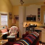 With a ground-floor bedroom, this tiny cottage on the Oregon Coast supports single-level living. It has a 416 sq ft main level plus a sleeping loft.   www.facebook.com/SmallHouseBliss