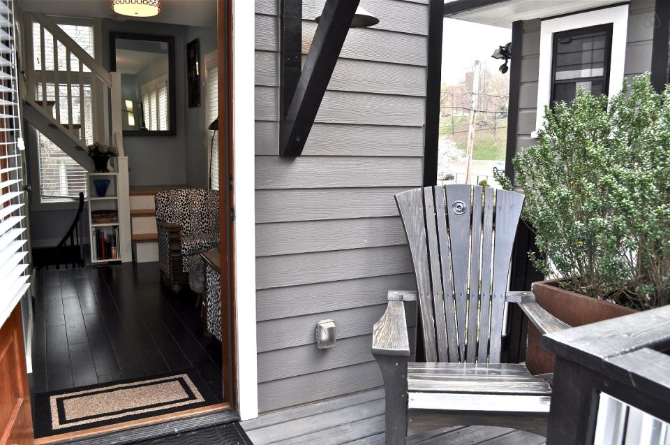 The Birdhouse, a tall and skinny tiny house with the kitchen, living room and bedroom each occupying one of the three floors. | www.facebook.com/SmallHouseBliss