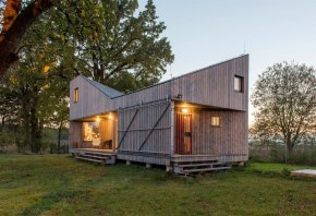 A distinctive folded roof tops this small energy-efficient house in Bohemia. It has a 624 sq ft ground floor plus two bedroom lofts. | www.facebook.com/SmallHouseBliss