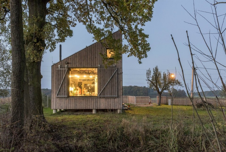 A distinctive folded roof tops this small energy-efficient house in Bohemia. It has a 624 sq ft ground floor plus two bedroom lofts.   www.facebook.com/SmallHouseBliss