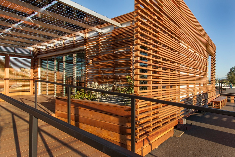 INhouse, an entry at Solar Decathlon 2015, has a covering of redwood strips to shade the walls and keep the home cooler. It has one bedroom plus a flex space in 986 sq ft. | www.facebook.com/SmallHouseBliss