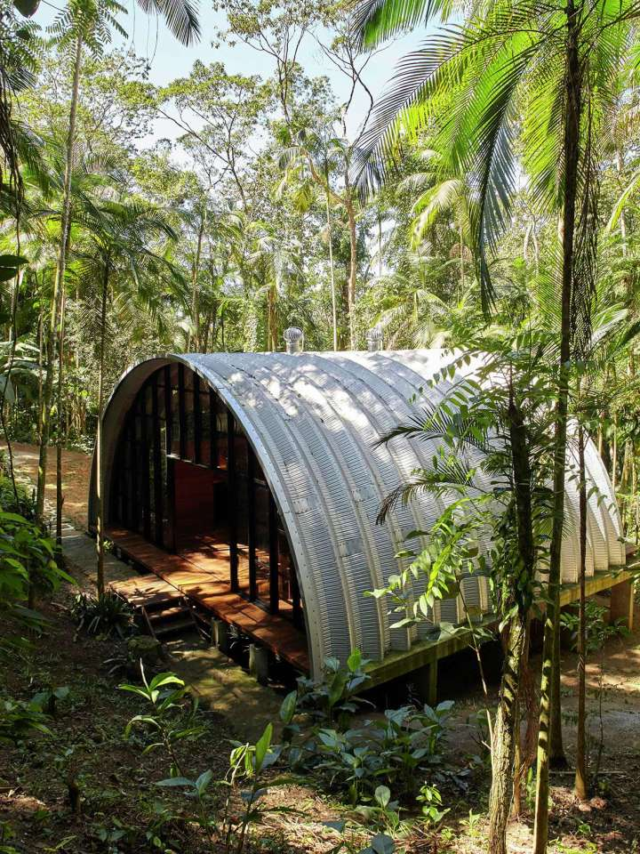 """""""Arca"""", an arched retreat in the Brazilian rainforest created from a prefab metal building. It has two bedrooms in 781 sq ft. 