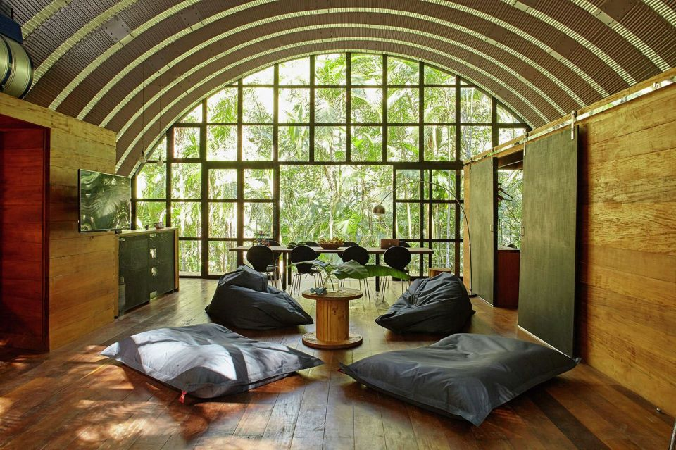 """Arca"", an arched retreat in the Brazilian rainforest created from a prefab metal building. It has two bedrooms in 781 sq ft. 