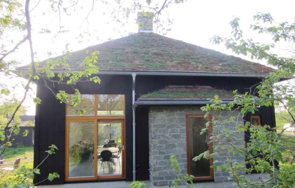 A vacation cabin in southern Sweden built in the regions's vernacular style with dovetailed log walls and a living green roof. It has two bedrooms and a loft in roughly 750 sq ft. | www.facebook.com/SmallHouseBliss
