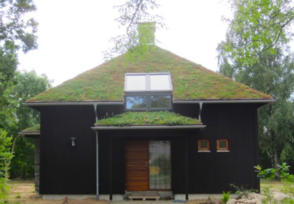 A vacation cabin in Sweden built in the regions's vernacular style with dovetailed log walls and a living green roof. It has two bedrooms and a loft in roughly 750 sq ft. | www.facebook.com/SmallHouseBliss