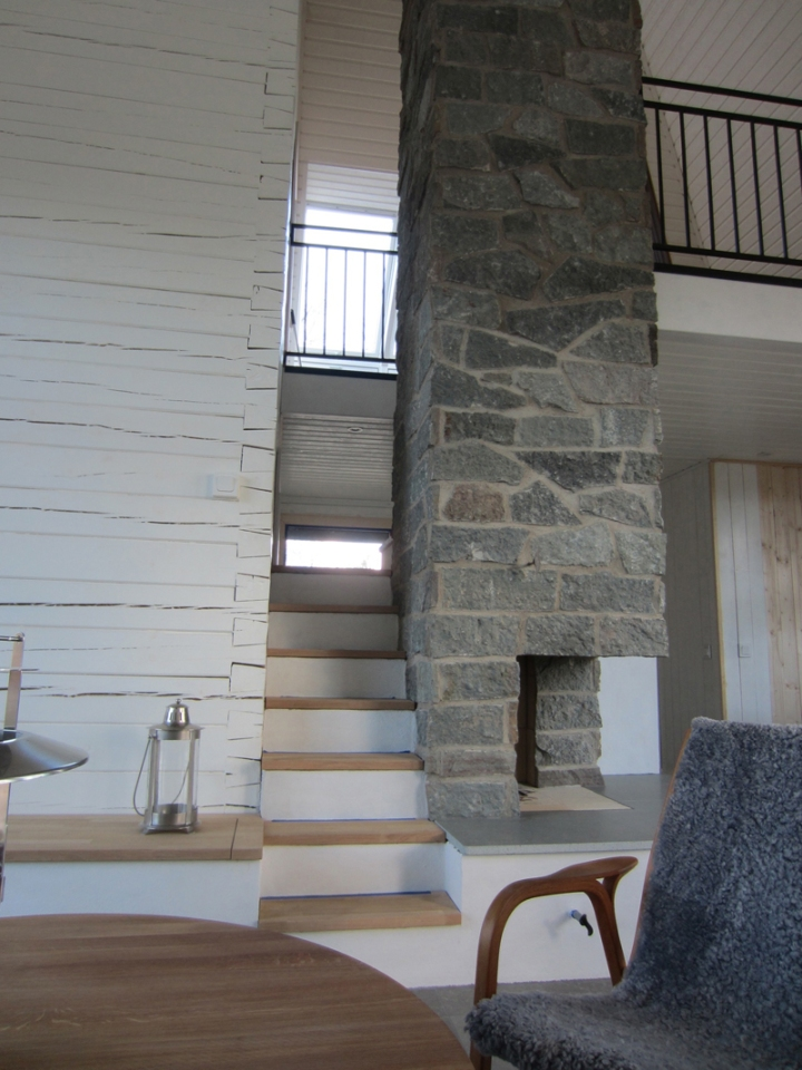 A vacation cabin in Sweden built in the regions's vernacular style with dovetailed log walls and a living green roof. It has two bedrooms and a loft in roughly 750 sq ft.   www.facebook.com/SmallHouseBliss