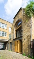 A brick coach house in London dating back to the 1800s was renovated with a new interior that makes extensive use of birch plywood. | www.facebook.com/SmallHouseBliss
