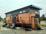 The Waterhaus, a tiny sustainable prefab designed for a healthy indoor environment. It has one bedroom in 450 sq ft.   www.facebook.com/SmallHouseBliss