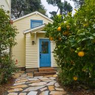Although just 469 sq ft total, Susan's backyard cottage squeezes in spiral stairs to the loft bedroom. | www.facebook.com/SmallHouseBliss