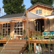 This small garden cottage located in an allotment garden has a kitchenette, half bath and sleeping loft in 258 sq ft. | www.facebook.com/SmallHouseBliss