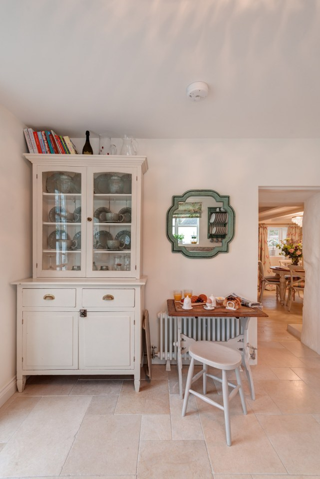 """Sweetpea Cottage, a 300-year-old plastered stone cottage in Cornwall. The two-bedroom cottage was built in 1680 and recently updated in a """"vintage country glamour"""" style to brighten the interior.   www.facebook.com/SmallHouseBliss"""