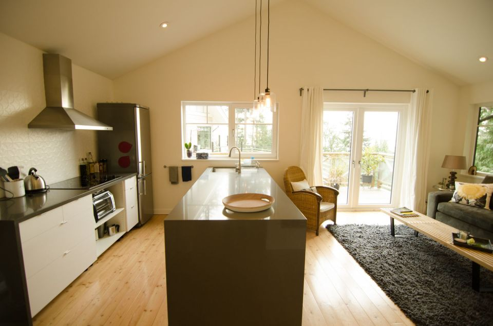 This contemporary coastal cottage has an open floor plan with one bedroom in 600 sq ft.   www.facebook.com/SmallHouseBliss