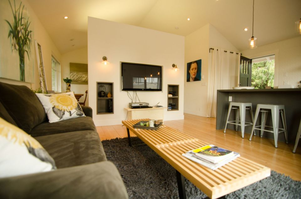 This contemporary coastal cottage has an open floor plan with one bedroom in 600 sq ft. | www.facebook.com/SmallHouseBliss