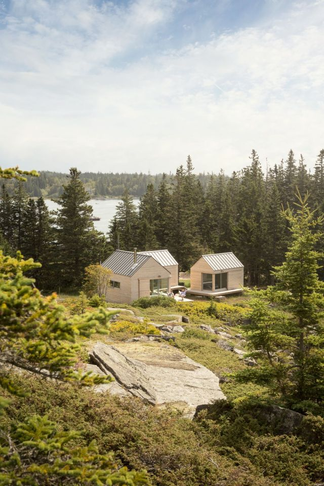 A trio of tiny cabins forms a seasonal vacation retreat in an old quarry. One cabin is the living/dining/kitchen pavilion, the other two are sleeping cabins. | www.facebook.com/SmallHouseBliss
