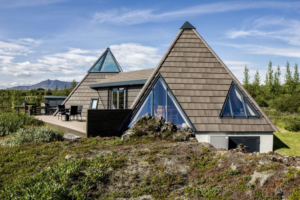 Iceland's volcanoes were the inspiration for this stunning pyramid-shaped vacation cottage. It has three small bedrooms plus a loft. | www.facebook.com/SmallHouseBliss
