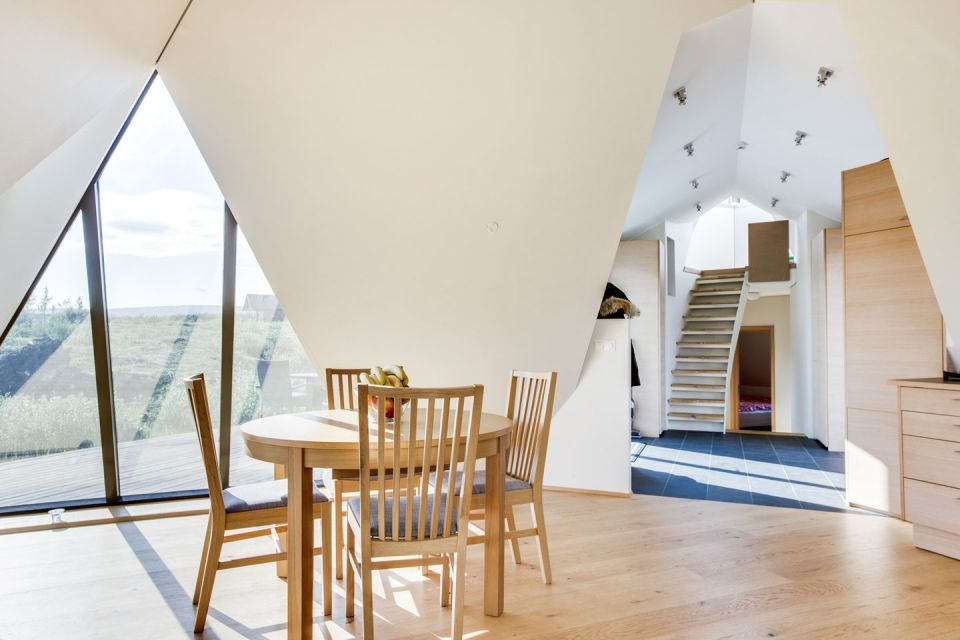 Iceland's volcanoes were the inspiration for this stunning pyramid-shaped vacation cottage. It has three small bedrooms plus a loft.   www.facebook.com/SmallHouseBliss