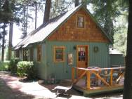 Built in the 1920s, Wildflower Cabin is loaded with vintage charm. It has one bedroom and a loft in 600 sq ft. | www.facebook.com/SmallHouseBliss