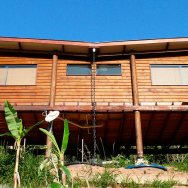 Casa em Guararema is a small wooden house in Brazil perched on eucalyptus poles. It has one bedroom in roughly 460 sq ft. | www.facebook.com/SmallHouseBliss