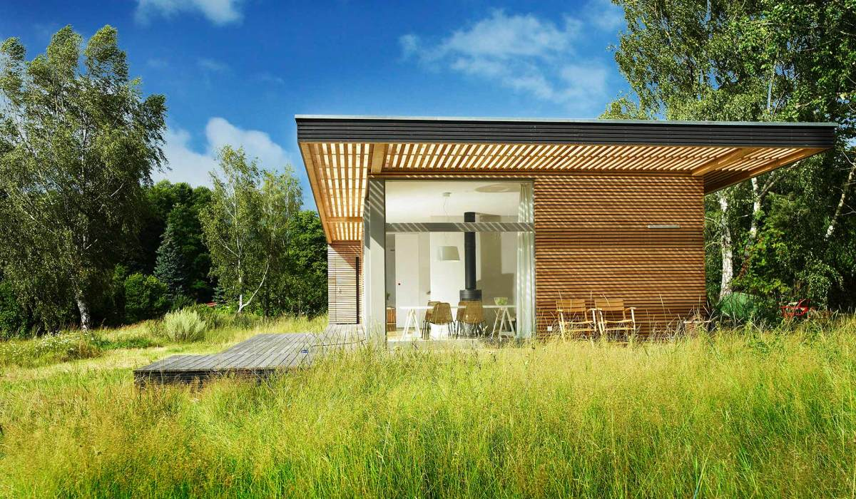 Inspired by Scandinavian summerhouse culture, Sommerhaus PIU is a  clean-lined prefab vacation home