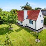 This tiny cottage in Denmark was built in 1925 and later expanded. It now has a 420 sq ft main level with one bedroom plus an attic bedroom. | www.facebook.com/SmallHouseBliss