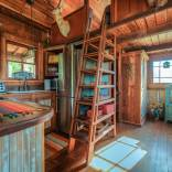 The rustic Cowboy Cabin was built from salvaged materials. The 12'x28' cabin has 2 sleeping lofts. | www.facebook.com/SmallHouseBliss