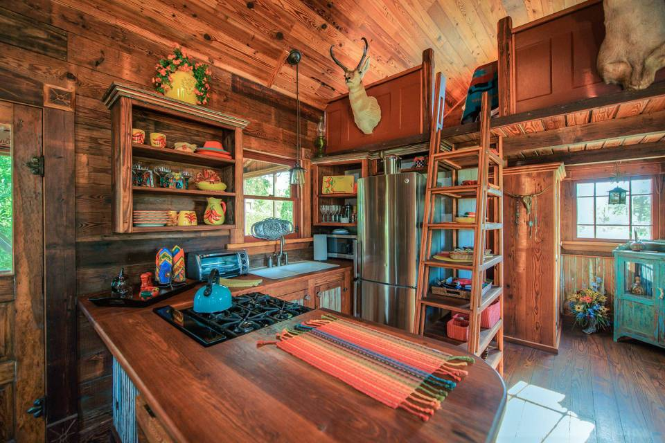 The rustic Cowboy Cabin was built from salvaged materials. The 12'x28' cabin has 2 sleeping lofts.   www.facebook.com/SmallHouseBliss