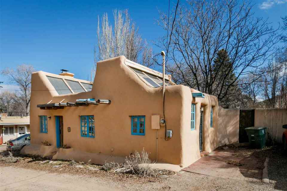 A 1930s Pueblo Revival style adobe home retrofitted with a rooftop active solar system. It is 510 sq ft with a loft bedroom. | www.facebook.com/SmallHouseBliss