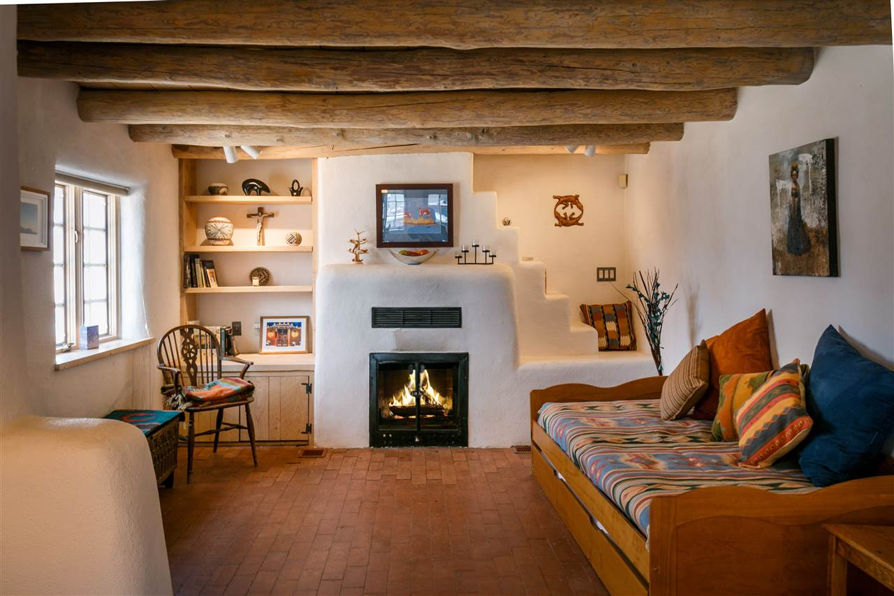 A 1930s Pueblo Revival Style Adobe Home Retrofitted With A Rooftop Active  Solar System. It