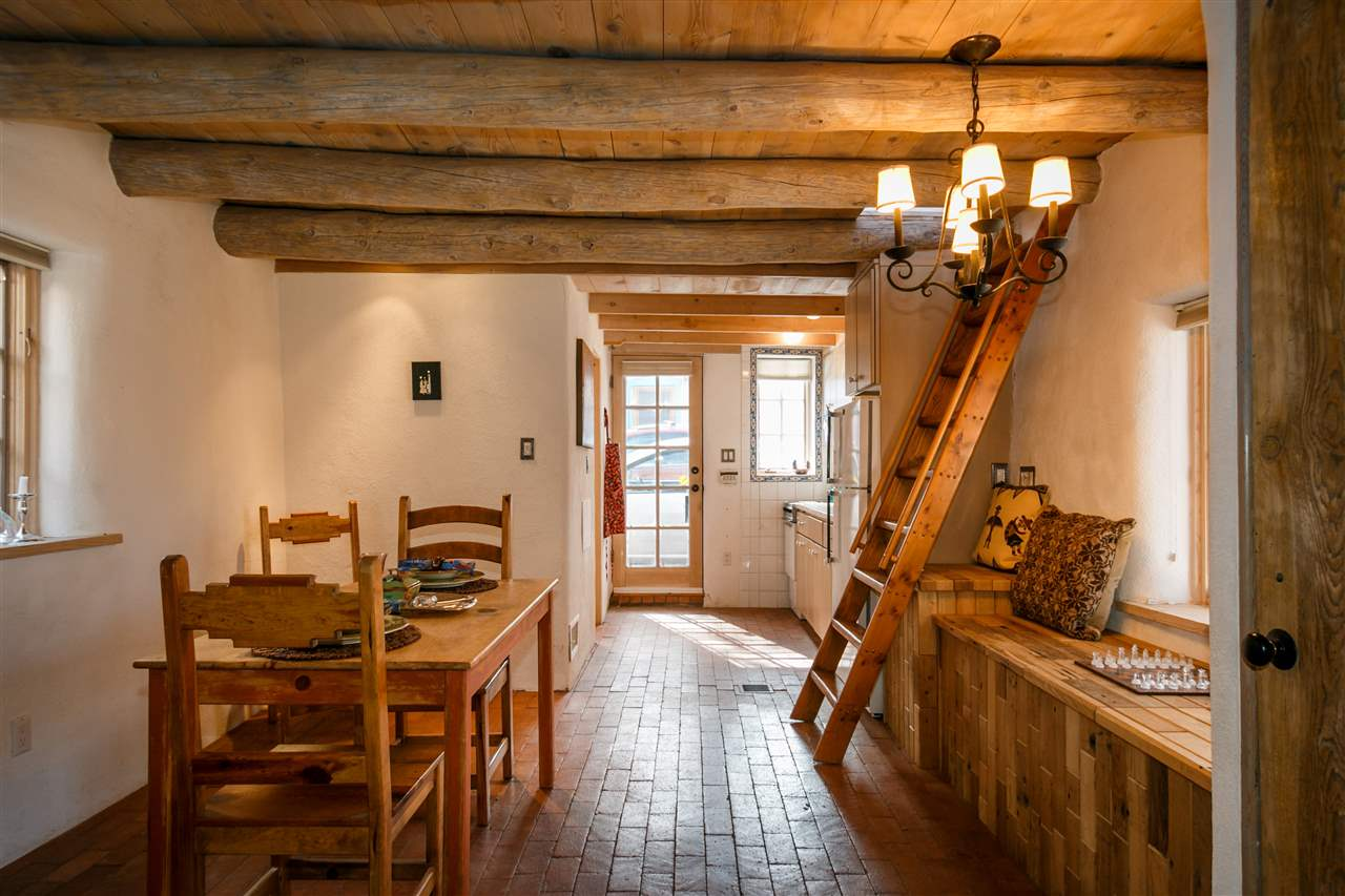Santa fe style interior design - A 1930s Pueblo Revival Style Adobe Home Retrofitted With A Rooftop Active Solar System It
