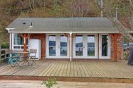 This breezy beach cottage was renovated from an old-timer fishing cabin. It has a 336 sq ft studio floor plan.   www.facebook.com/SmallHouseBliss