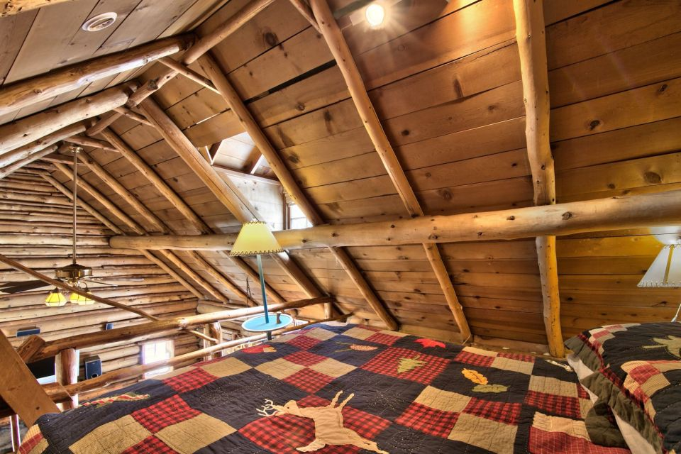 This saddle-notched log cabin was built in 1929 on Lake Tahoe. It has a 475 sq ft footprint plus a loft bedroom. | www.facebook.com/SmallHouseBliss