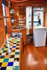 """""""Tao"""", a tiny houseboat on Seattle's Lake Union. Tao has roughly 260 sq ft of inside space plus a sleeping loft. 