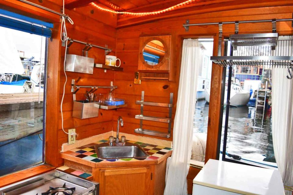 """""""Tao"""", a tiny houseboat on Seattle's Lake Union. Tao has roughly 260 sq ft of inside space plus a sleeping loft.   www.facebook.com/SmallHouseBliss"""