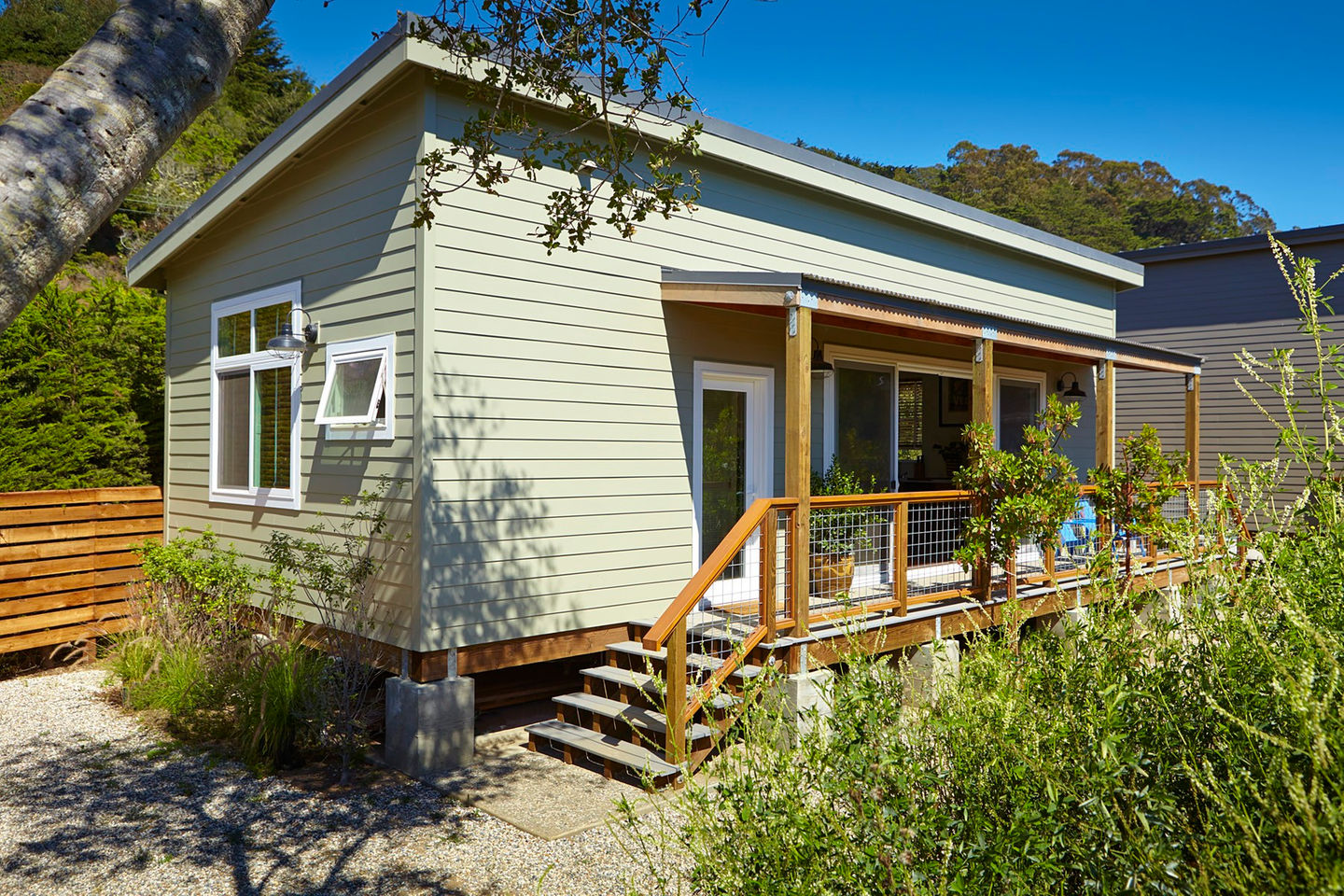 Cost saving strategies in a small california beach house for Tiny cabin designs