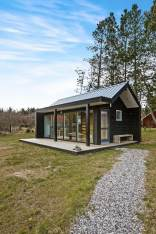 This Scandinavian Modern tiny house in Denmark has a 258 sq ft studio floor plan with sleeping loft. | www.facebook.com/SmallHouseBliss