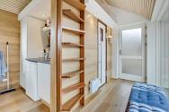This Scandinavian Modern tiny house in Denmark has a 258 sq ft studio floor plan with sleeping loft. | www.facebook.com/SmallHouseBliss