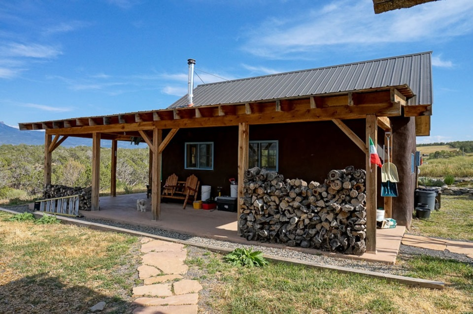 This small straw bale house is off the grid on 40 acres of Colorado pasture, forest and canyon. It has one bedroom on the 468 sq ft ground floor plus a loft.   www.facebook.com/SmallHouseBliss