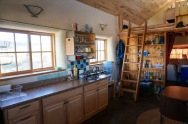 This small straw bale house is off the grid on 40 acres of Colorado pasture, forest and canyon. It has one bedroom on the 468 sq ft ground floor plus a loft. | www.facebook.com/SmallHouseBliss