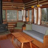 The Perch, a 1920s log cabin resembling a forest fire lookout tower. It has one bedroom in roughly 600 sq ft.   www.facebook.com/SmallHouseBliss