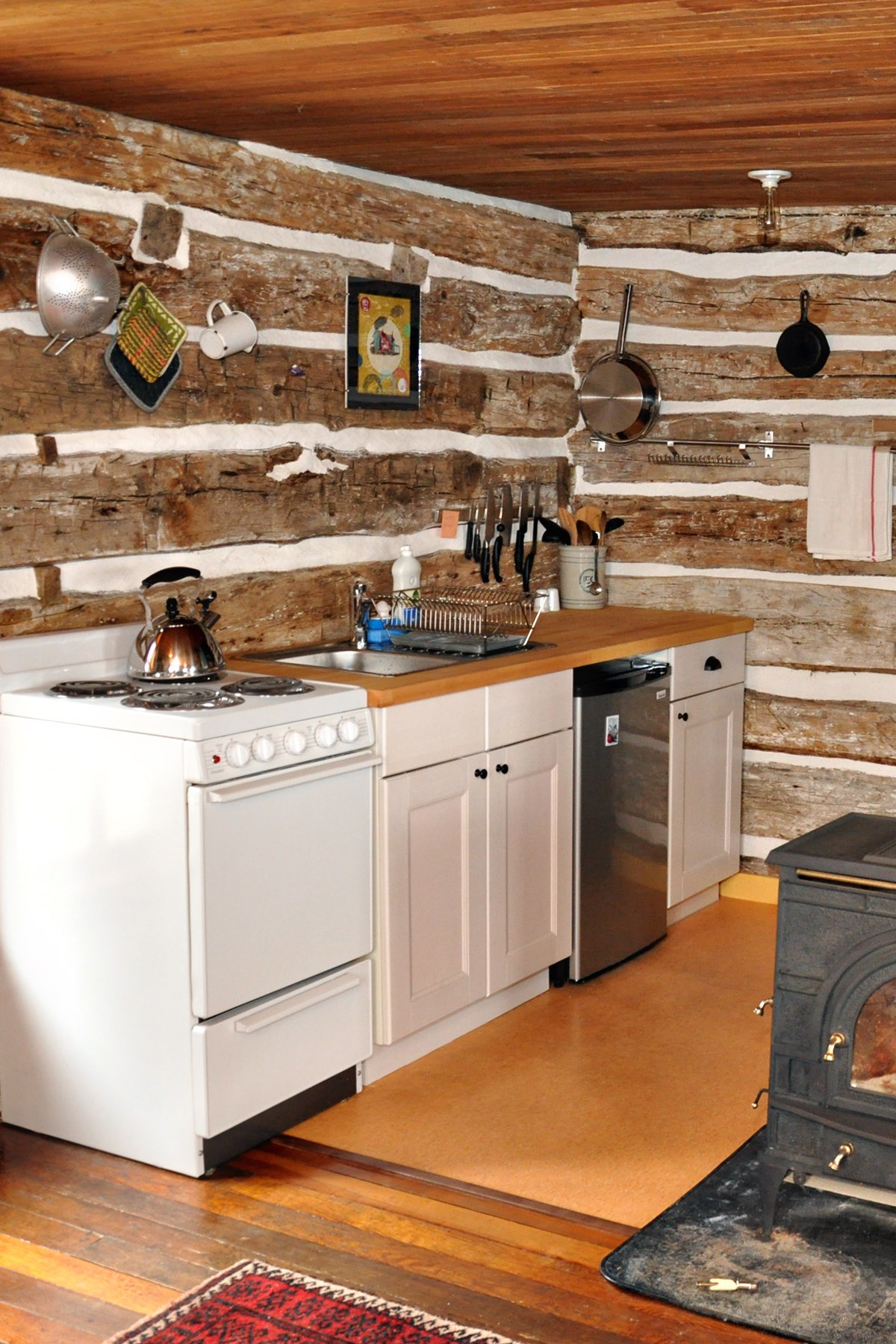 Gallery: Trout River Log Cabin | Small House Bliss on log cabin kitchen countertops, log cabin designer kitchens, log home kitchen, log cabin kitchen plans, log cabin kitchen pulls, log cabin kitchen seating, log cabin outdoor kitchen, log cabin kitchen sinks, log cabin kitchen range, log cabin kitchen faucets, log cabin kitchen curtains, log cabin electrical, log cabin kitchens with stone, log cabin kitchen tiles, log cabin kitchens with islands, log cabin kitchen backsplash, log cabin kitchen ideas, log cabin refrigerator, log cabin kitchens and baths, log cabin kitchen layout,