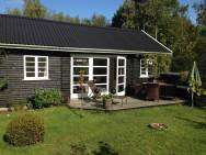 Summerhouse in Denmark with 463 sq ft of inside space. It has two small bedrooms plus a sleeping loft. | www.facebook.com/SmallHouseBliss
