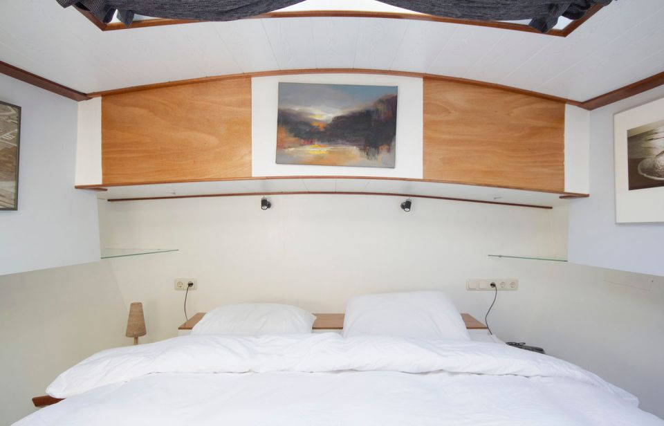 A canal barge built in 1908 was converted into this comfortable two-bedroom houseboat in Amsterdam.   www.facebook.com/SmallHouseBliss