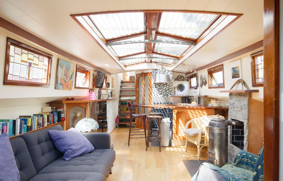 A canal barge houseboat in Amsterdam | Small House Bliss