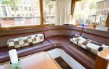 A canal barge built in 1908 was converted into this comfortable two-bedroom houseboat in Amsterdam. | www.facebook.com/SmallHouseBliss