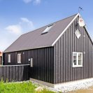 This Danish summerhouse was inspired by the neighboring fishermen's sheds. It has one bedroom on the 375 sq ft ground floor, plus a sleeping loft. | www.facebook.com/SmallHouseBliss